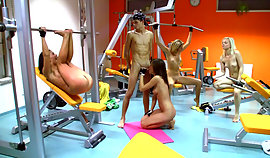 Unclothes young gang are working out in a night gym